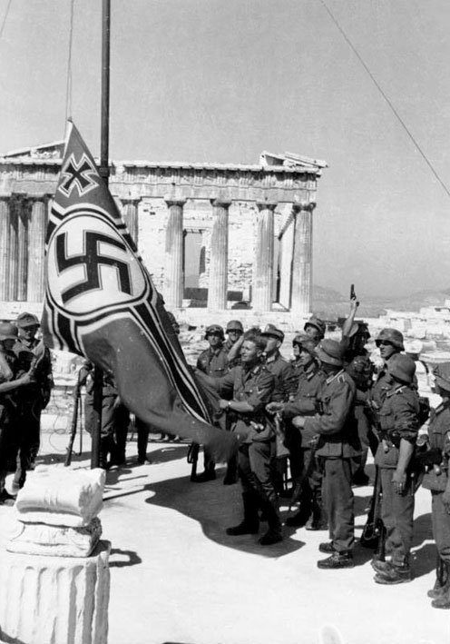 Nazi soldiers raising the Nazi War Flag over the Acropolis.