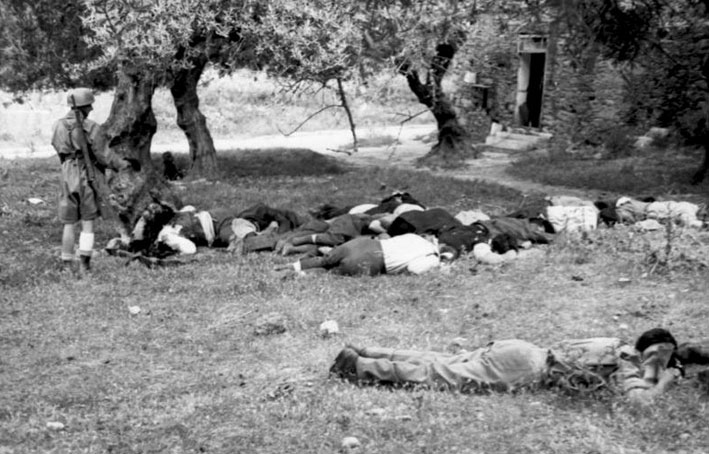 Greek civilians lying dead in an olive orchard